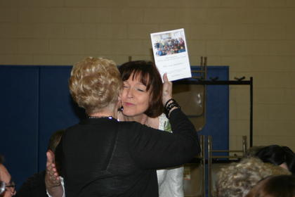Lisa Hawkins receives a hug from a well-wisher prior to the ExCEL ceremony.