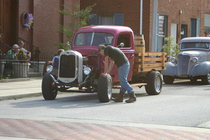 A pickup hauling a whiskey barrel parked in front of Hodgenville Christian Church.