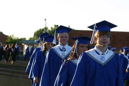 Front to back, LaRue County High School graduates, Kevin Mackie, Amber Carrier, Jacob Ovesen and Chelsea Gray waited in line to receive their diplomas.