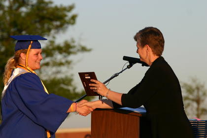 Ashley Cottrell accepted the Agriculture Award from her teacher, Misty Bivens.