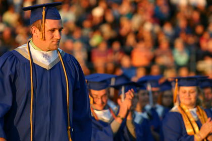 Cole Hughes, salutatorian for the Class of 2013, was applauded by his classmates as he walked to the stage.