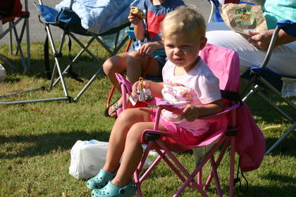 Laurel Highbaugh, 1, waits for the parade to begin.