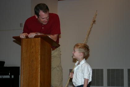 Emcee Phillip Setters asks Maddax Allen about his fishing pole. Maddax was the winner of the Little Abe, ages 3-6 contest.