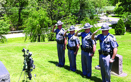 Post 4 Kentucky State Troopers saluted fallen Trooper Eddie Harris May 15 at Red Hill Cemetery in Hodgenville. Trooper Harris, 29, was fatally shot Nov. 7, 1979, during the course of a traffic stop. According to a witness, Trooper Harris was struck first by a shot fired from inside the suspect's vehicle and again as he lay in the road. Trooper Harris was assigned to Post 4 Elizabethtown and had served with the Kentucky State Police for six and a half years. He was survived by his wife and three young children. In honor of his service and sacrifice, KY 3005 in Hardin County has been designated the Trooper Edward Harris Memorial Highway. Pictured from left are Post 4 Troopers Pete Binkley, Sgt. Kevin Burton, Brandon Brooks and Brad Riley.