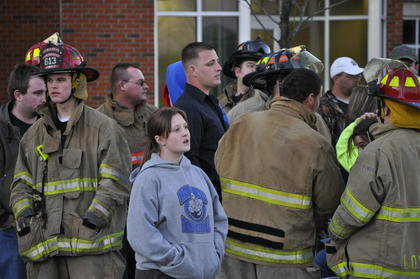 Several spectators and firefighters waited for the firefighter challenge to begin Saturday.
