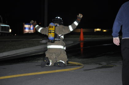 Buffalo firefighter Craig Wright celebrated finishing the hose drag portion of the firefighter challenge.