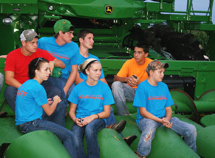 FFA students turned the corn head on a combine into stadium seating during J.D. Shelburne's finale concert at Saturday's AGstravaganza. Front from left, Cristine Shive, Brittany Blair, Dakota Price; back, Michael Colton Hornback, Koy Lindsey, Michael Hill, Justin Hornback and Hayden Waddle.