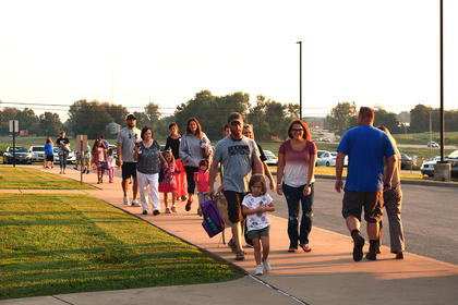 Children were escorted to the school by parents and grandparents on the first day of school at Abraham Lincoln Elementary School.