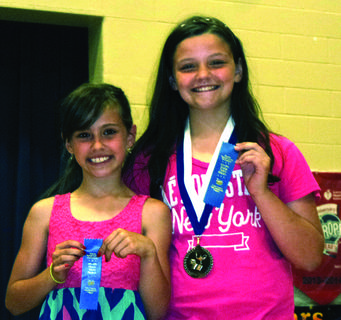 Fourth-graders inducted into the Duke Talent Identification Program are Brenna Southwood and MaKenna Montgomery.