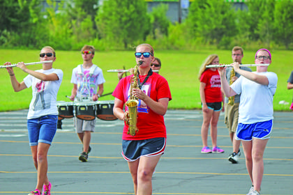 Above, from left, Flute:  Katie Roberts, Alto Sax:  Kaylee Smith, Flute:  Ally Rae Milford