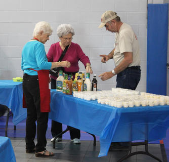 The LaRue County Cattlemen's Association served 145 steak dinners at the LaRue County Band banquet held on May 6. Bobby Garrison, Pat Hollingshead, Ruby Garrison and Carl Dunn looked over the last-minute preparations.
