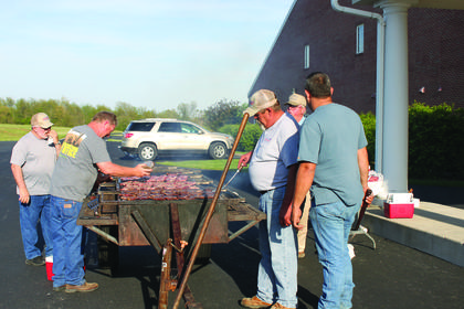 The LaRue County Cattlemen's Association served 145 steak dinners at the LaRue County Band Banquet held on May 6. At the grill is Frankie Weller, Kelly Flanders, Jerry Gaddie, Donald McDowell, and Rodney McDowell.
