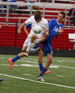 "Bardstown Bethlehem's Cailin Jones and LaRue County's Jacob ""Catfish"" Hurt leap for a ball during the Boys' 5th Region Soccer Tournament quarterfinal in Bardstown."