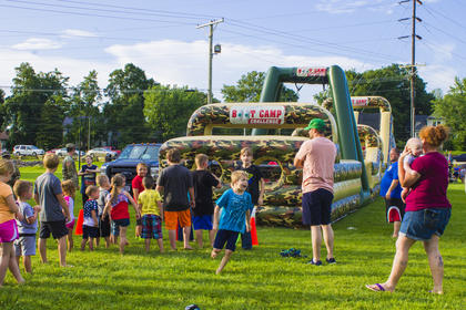 The National Guard provided an inflatable obstacle for the event.