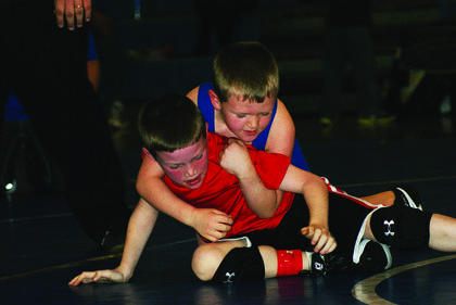 Chase Ireland, bottom, tries to break away from Jake Heady.