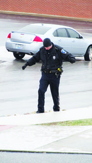 Hodgenville officer Brandon Casey did a balancing act on an icy street.