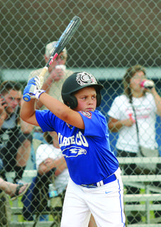 LaRue County's Hayden Cleveland waited for the pitch in opening round action in the West Kentucky Cal Ripken State Tournament at LaRue County Park and Recreation.