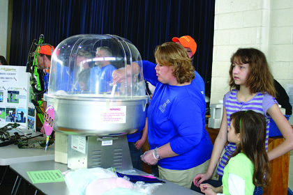 Misty Wilmoth worked the cotton candy booth for 4-H.