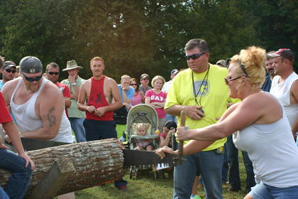 Jaqueline Montgomery and her husband Luke Montgomery participate in the cross cut competition for the first time.