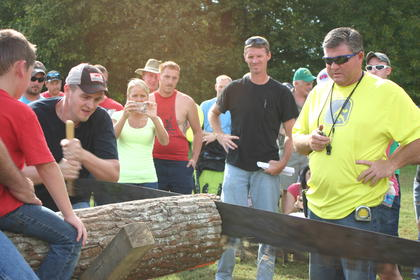J.D. Rucker readies for another pull of the saw in his direction, during the cross cut competition.