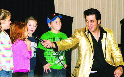 Caleb Brown, an Elvis tribute artist, sang and danced with children during the show.
