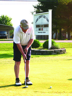 Doug Gary practiced putting in front of the LaRue County Clubhouse before the Bob Cundiff Golf Tournament.