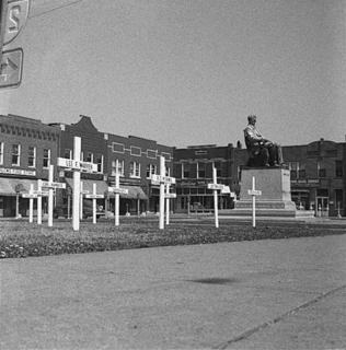 Crosses honoring LaRue County's fallen veterans were placed in downtown Hodgenville in the 1950s. The LaRue County Courthouse was located in front of the Lincoln statue at that time.