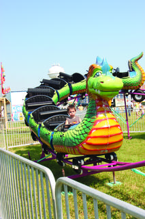 Benjamin Riggs took a ride on the Dragon Coaster during Kids Day at the Fair.