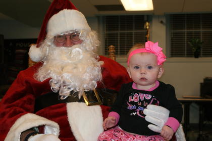 Madison West, 10 months, visited with Santa Saturday at Hodgenville City Hall.