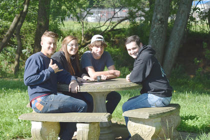 Alex Brooks, Lora Page, Michael Hill and Derek Barros are hanging out at CreekFront Park.