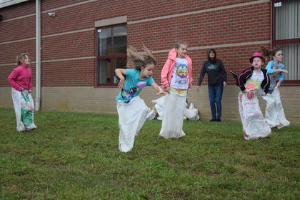 HES students compete in a sack race before the rain hit on Friday morning.