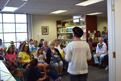 The library was filled with guests for their 100th anniversary celebration on Saturday May 27. Lynn Claycomb and Judy Greenwell gave a presentation about the Ladies Lincoln League, who established the first library in LaRue County 100 years ago. Pictured is Judy Greenwell giving a presentation about the Ladies Lincoln League.