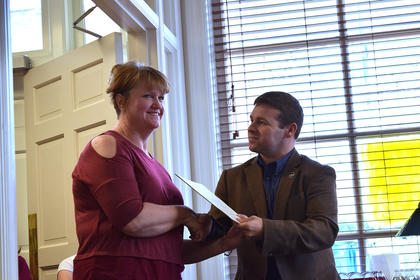Kentucky State Representative Brandon Reed presented Jolly with a Certificate of Achievement to commemorate the 100th anniversary of the Library.