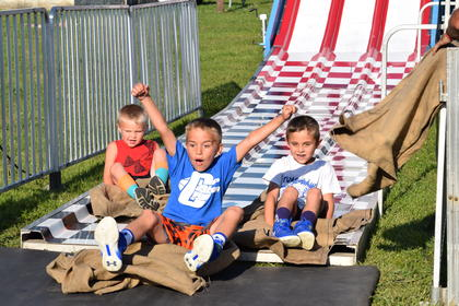 Tanner Noe is excited he was the first to make it down the big slide. Pictured with Noe are his cousins Konner and Keegan Gray.
