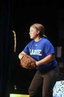 Emillee Cundiff performs a monologue about softball for the talent portion of the Distinguished Young Women program Saturday.