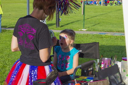 Rachel's Facepainting painted colorful designs onto several children throughout the evening.