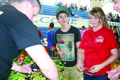 Brandon Grey and Michelle Key made a purchase at the Mini Mall. Agriculture students sold flowers from the school's greenhouse.