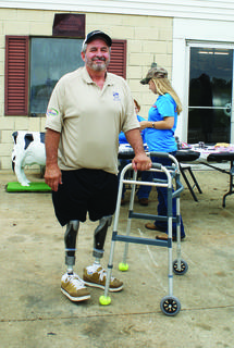 Gary Rock beat the odds when he survived a gruesome farming accident last year. He lost both legs above the knees in a silage chopper. Saturday, he took a few steps with his new prosthetic legs.