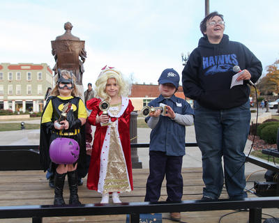 Winners of the 5-to-6 year olds costume contest were from left, Aeryn Grimes (scariest), Nikki Blair (cutest) and Gabriel Wright (original).