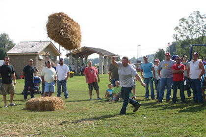 Bill Thomas starts off the hay bale toss competition.