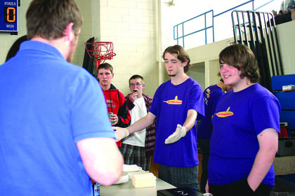 """Billy Meredith, Derek Dobson and Austin Kahill had a booming business at """"Yo Diggity Dog."""""""
