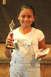 Cheyenne Castillo, 10, of Hodgenville won the karaoke contest in the children age group.