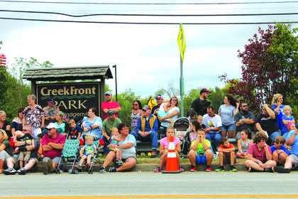 A crowd watched floats along the parade route in front of CreekFront Park Saturday. Click through the slideshow to see more photos from the weekend.