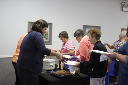 Marcy Ward, an employee of the Extension Service, served participants of Taste of LaRue.