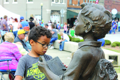 "Five-year-old Myles Dandy was curious about what kind of book ""Boy Lincoln"" was reading."