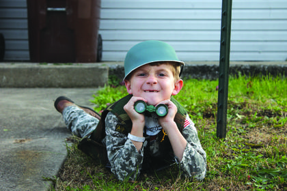 Soldier Seth Williamson, 7, was spying on the square with his binoculars.