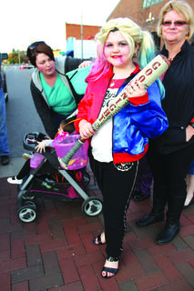 Madeline Warren, 9, wielded a baseball bat as part of her Harley Quinn costume.