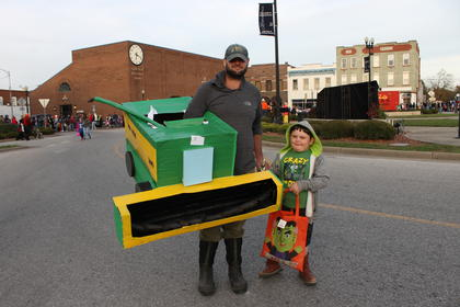 Charlie and Asa Perkins harvested candy with a homemade John Deer costume.