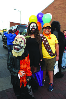 Twisty the clown smiled big for the camera along with Russel from up and a dead cat who had lost all her nine lives. Pictured left to right are Casey Webb, 8, Nyelli Webb, 12, and Eddie Calderon.