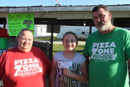 Pictured are Pizza Zone Owners Beth and Rick Keith with the first place winner Kenzey Rucker.